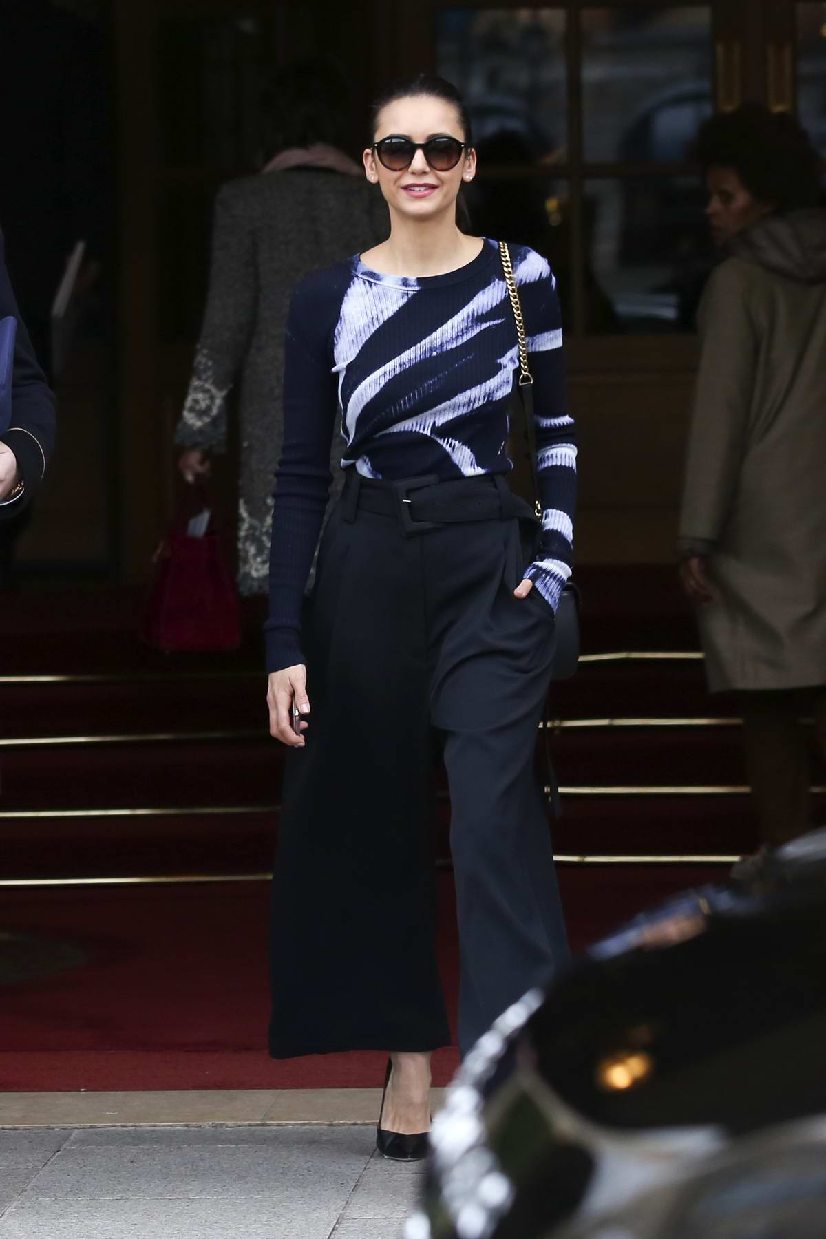 Nina Dobrev keeps it chic as she leaves the Ritz Hotel in Paris, France