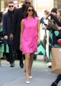 Nina Dobrev looks pretty in a short pink dress while greeting her fans outside AOL Build Studios in New York City