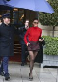 Nina Dobrev looks stylish in a red top with a black and red plaid mini skirt as she leaves the Ritz Hotel in Paris, France
