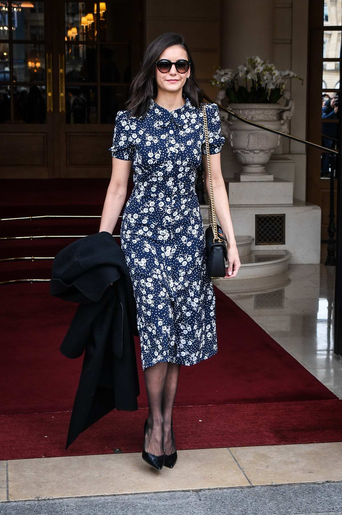 Nina Dobrev steps out in a navy blue floral print dress during Paris Fashion Week F/W 2019 in Paris, France