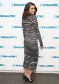 Nina Dobrev stuns in a striped form-fitting maxi dress while visiting Sirius XM in New York City