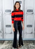 Nina Dobrev wears red and black stripes while visiting AOL Build Studio in New York City