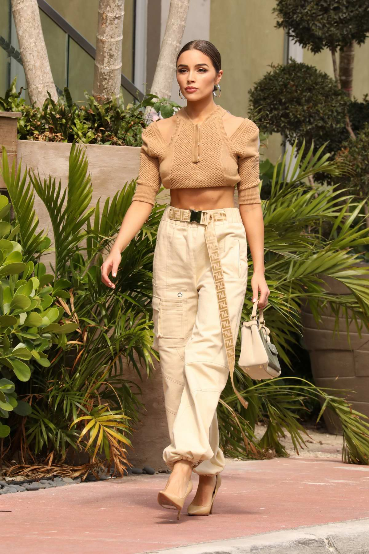 Olivia Culpo looks super stylish in a brown crop top, beige cargo pants with a Fendi belt and heels while out in Miami, Florida