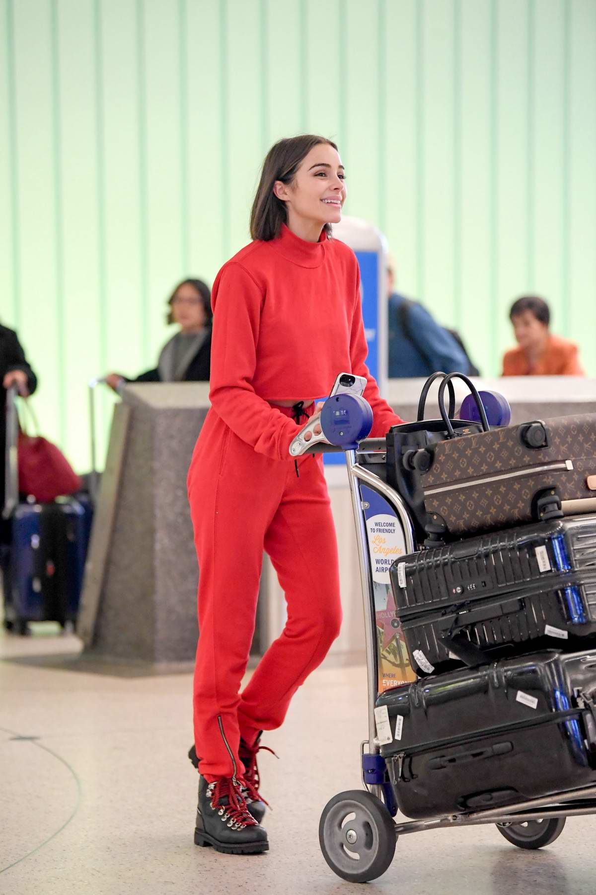 Olivia Culpo looks trendy in all red and clear glasses as she touches down at LAX Airport, Los Angeles