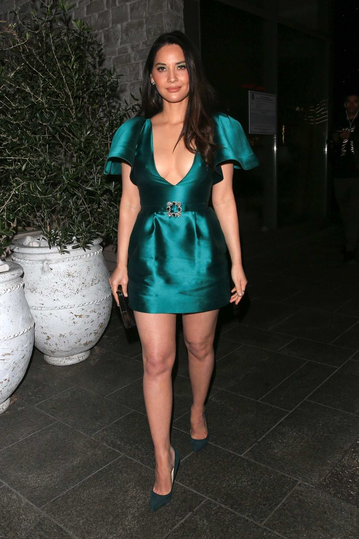 Olivia Munn stuns in a plunging green dress as she leaves Avra in Beverly Hills, Los Angeles