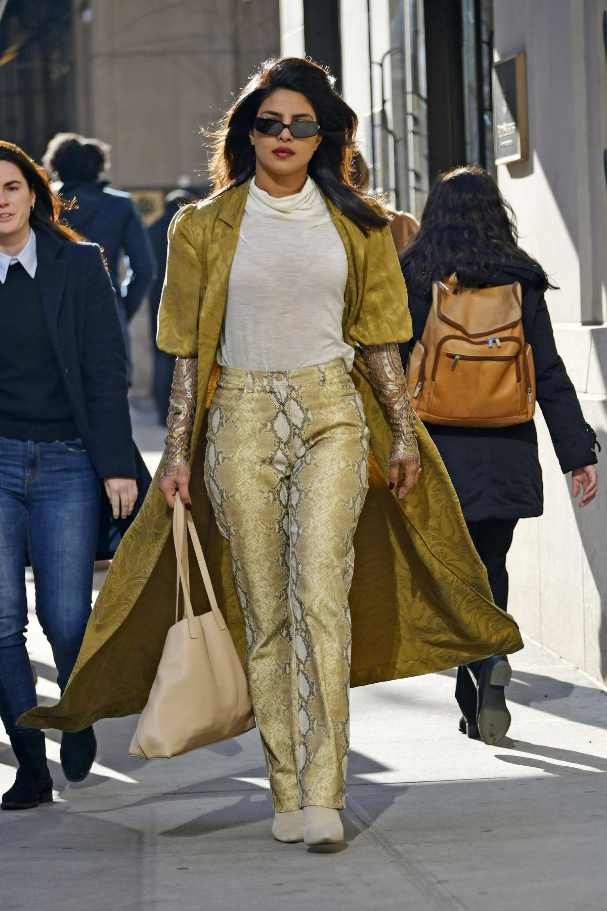 Priyanka Chopra spotted in a golden coat with a snakeskin print pants while out and about in New York City