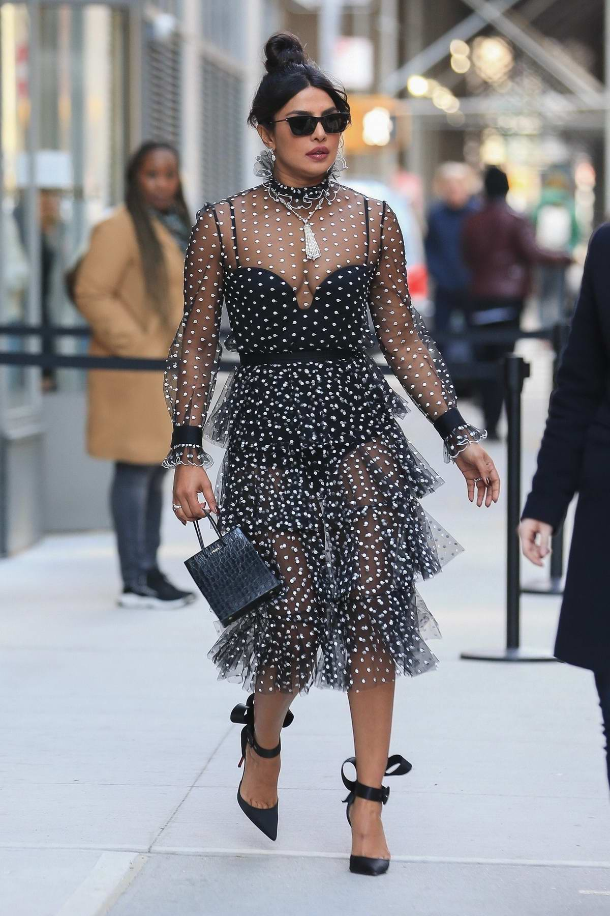 Priyanka Chopra steps out in a sheer polka dot dress after taping 'Watch What Happens Live' in New York City