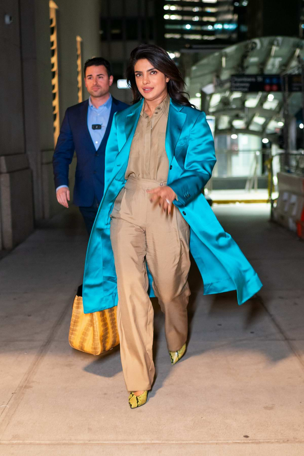 Priyanka Chopra steps out in a stylish turquoise blue overcoat and beige jumpsuit in New York City