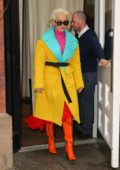 Rita Ora is a colorful sight while exiting her hotel in New York City