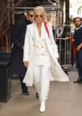Rita Ora looks stunning in a white outfit paired with a red purse while out in New York City