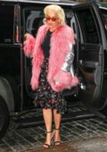 Rita Ora wears a pink fur jacket, black top and floral print skirt as she arrives to perform at 'Today' show in New York City