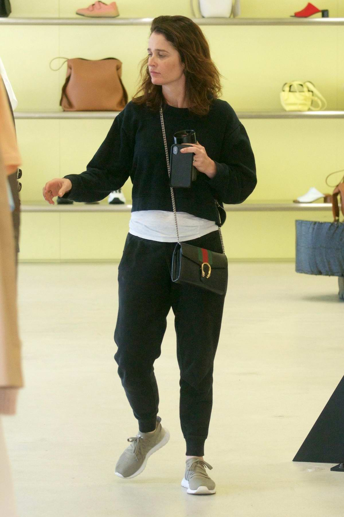 Robin Tunney keeps it casual while shopping at Acne Studios on Melrose in West Hollywood, Los Angeles