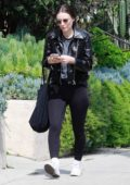 Rooney Mara dons black leather jacket with matching leggings and white converse while out following lunch with a friend in Los Angeles