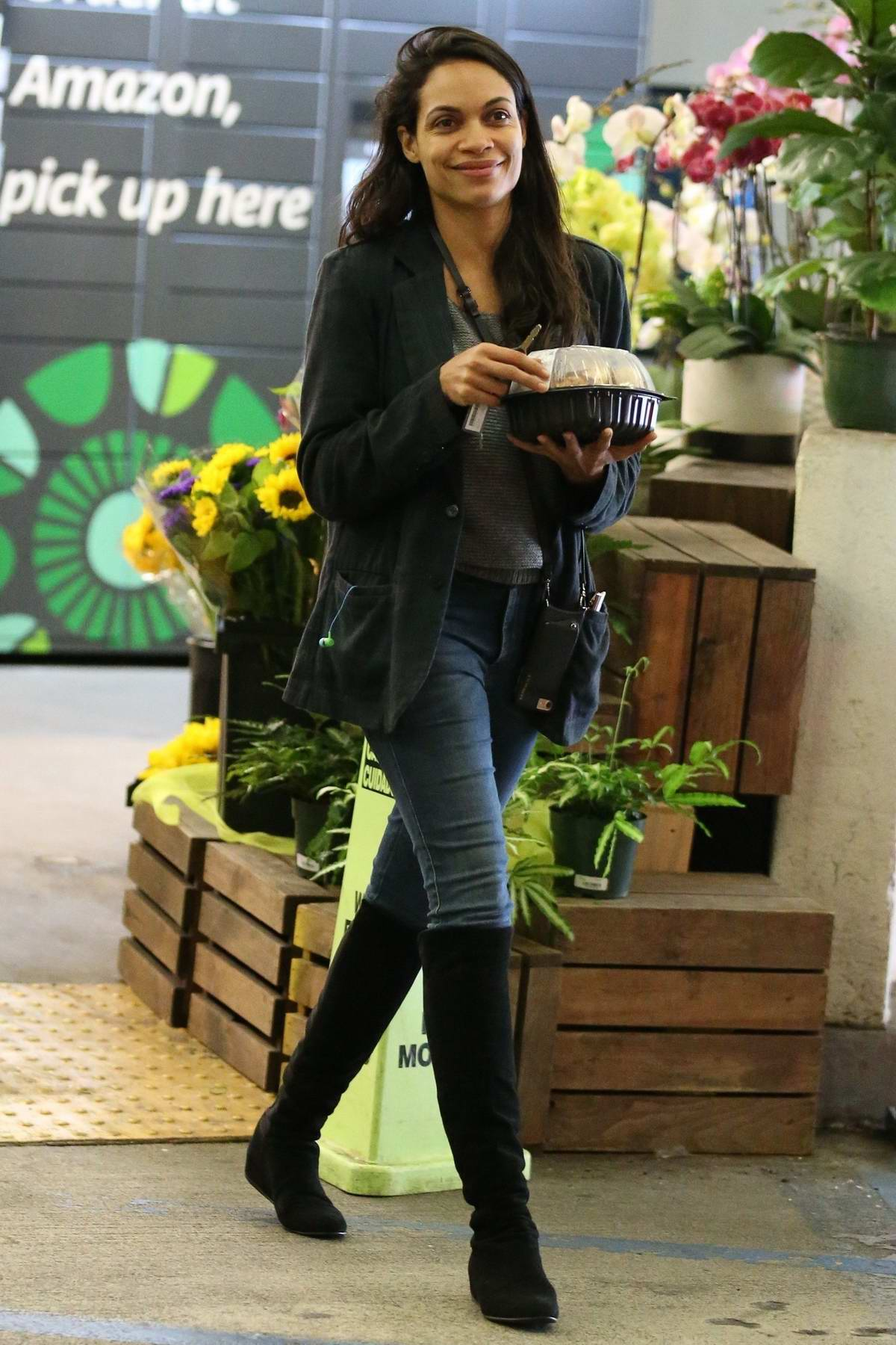 Rosario Dawson picks up a rotisserie chicken from Whole Foods in Beverly Hills, Los Angeles