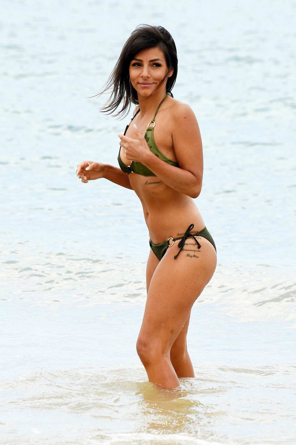 Roxanne Pallett enjoys the ocean in a green bikini while on holiday in Greece