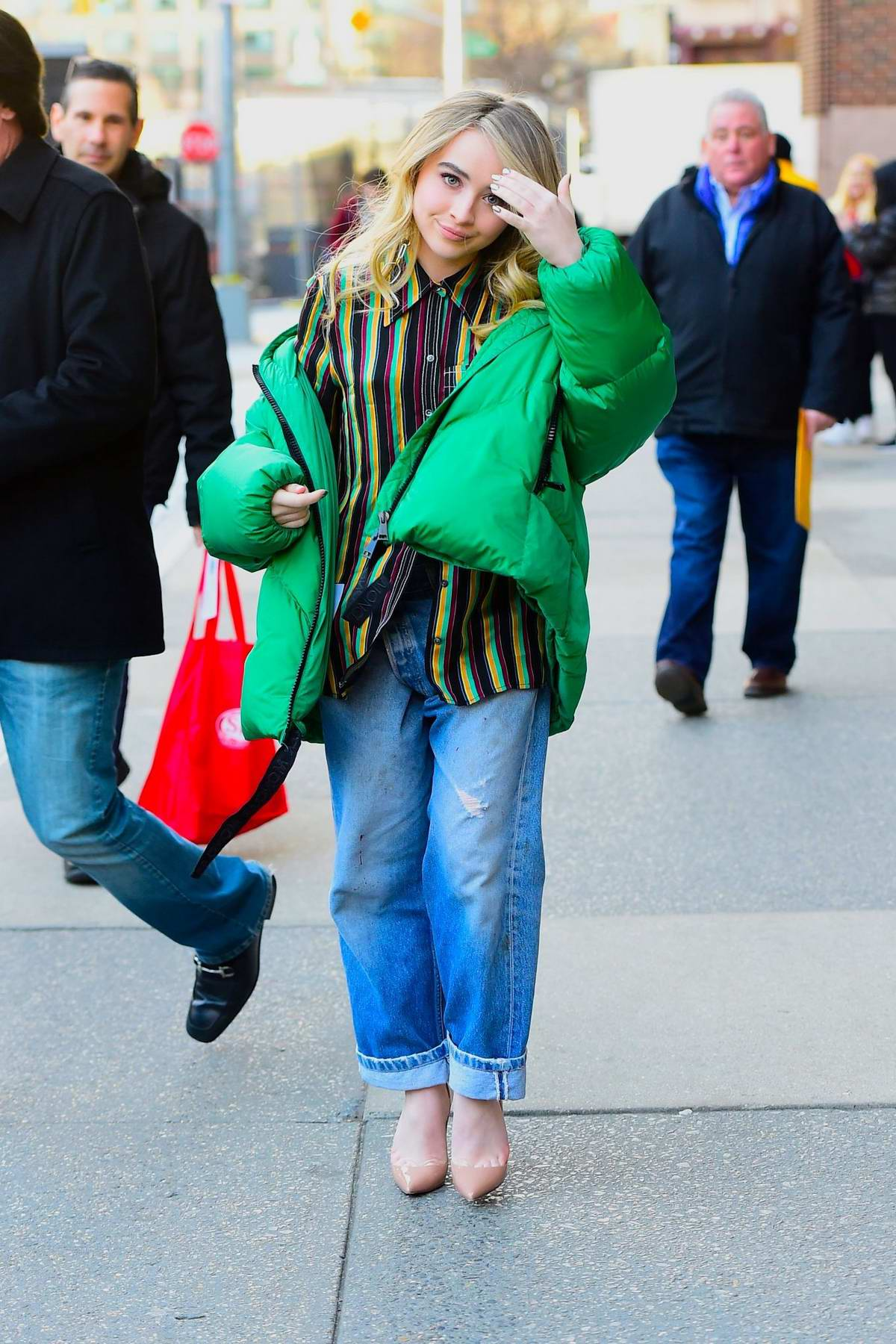 Sabrina Carpenter wears a green puffer jacket while out in New York City