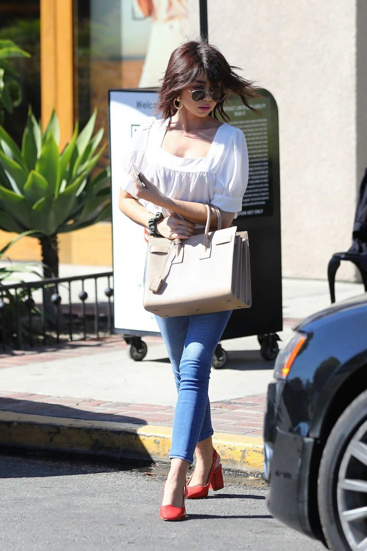 Sarah Hyland sports her new hairdo as she leaves Nine Zero One salon in Los Angeles