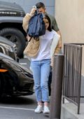 Selena Gomez hides her face behind her backpack as she arrives at a Music Studio in Los Angeles