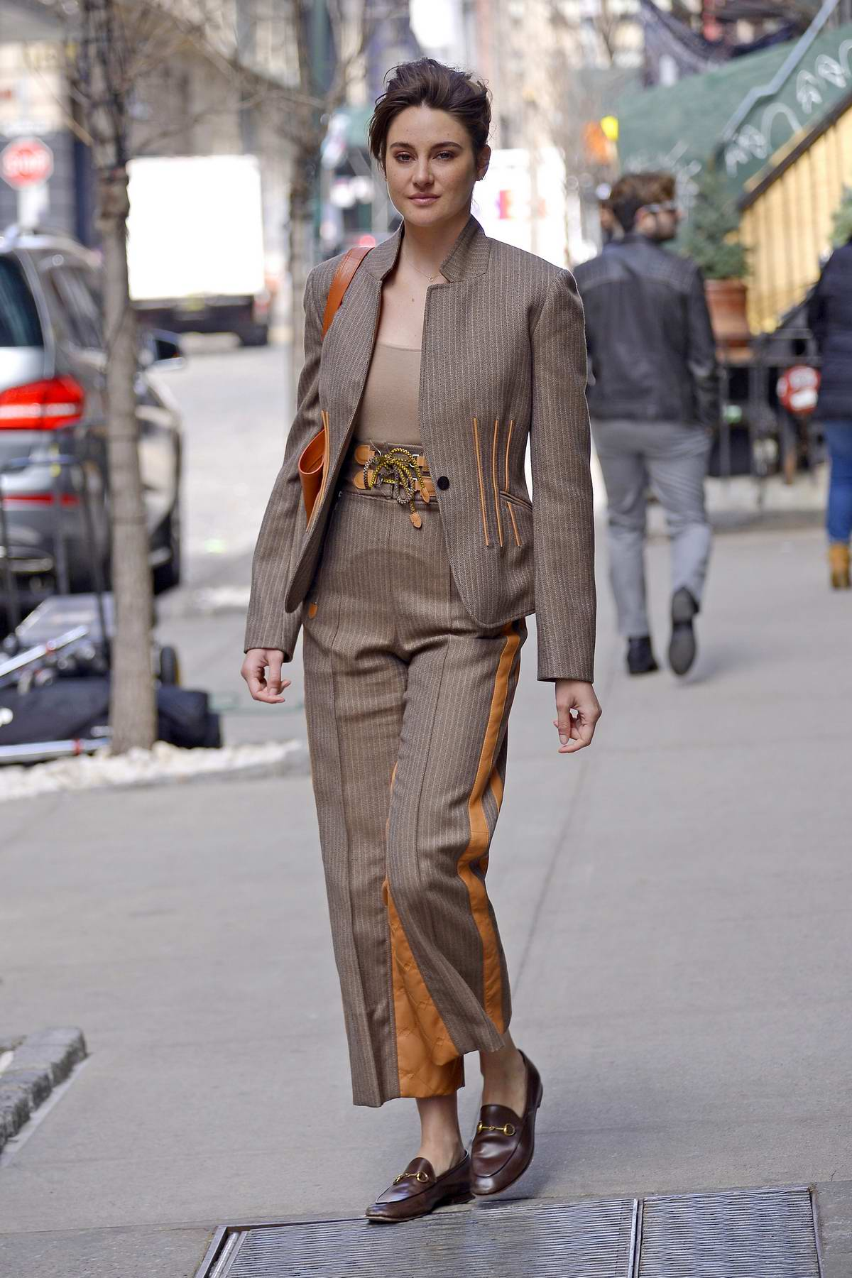 Shailene Woodley looks stylish in brown and orange pantsuit while out and about in New York City