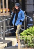 Shailene Woodley sports a denim jacket with a plaid yellow pants as she steps out in New York City