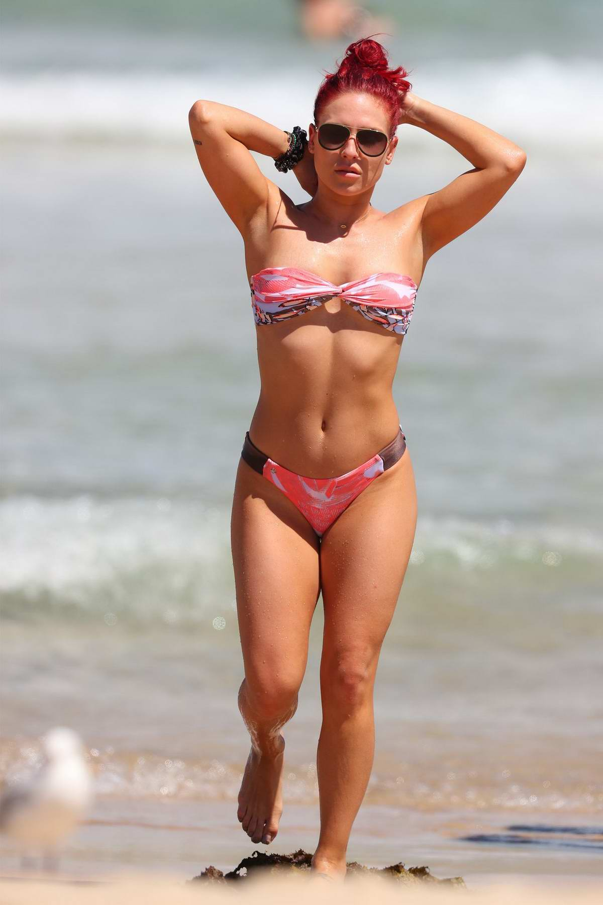 Sharna Burgess shows off her toned body in a pink bikini during a beach day at Bondi Beach in Sydney, Australia