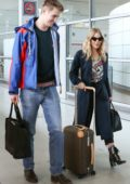 Sienna Miller and boyfriend Lucas Zwirner arrives at the CDG airport in Paris, France
