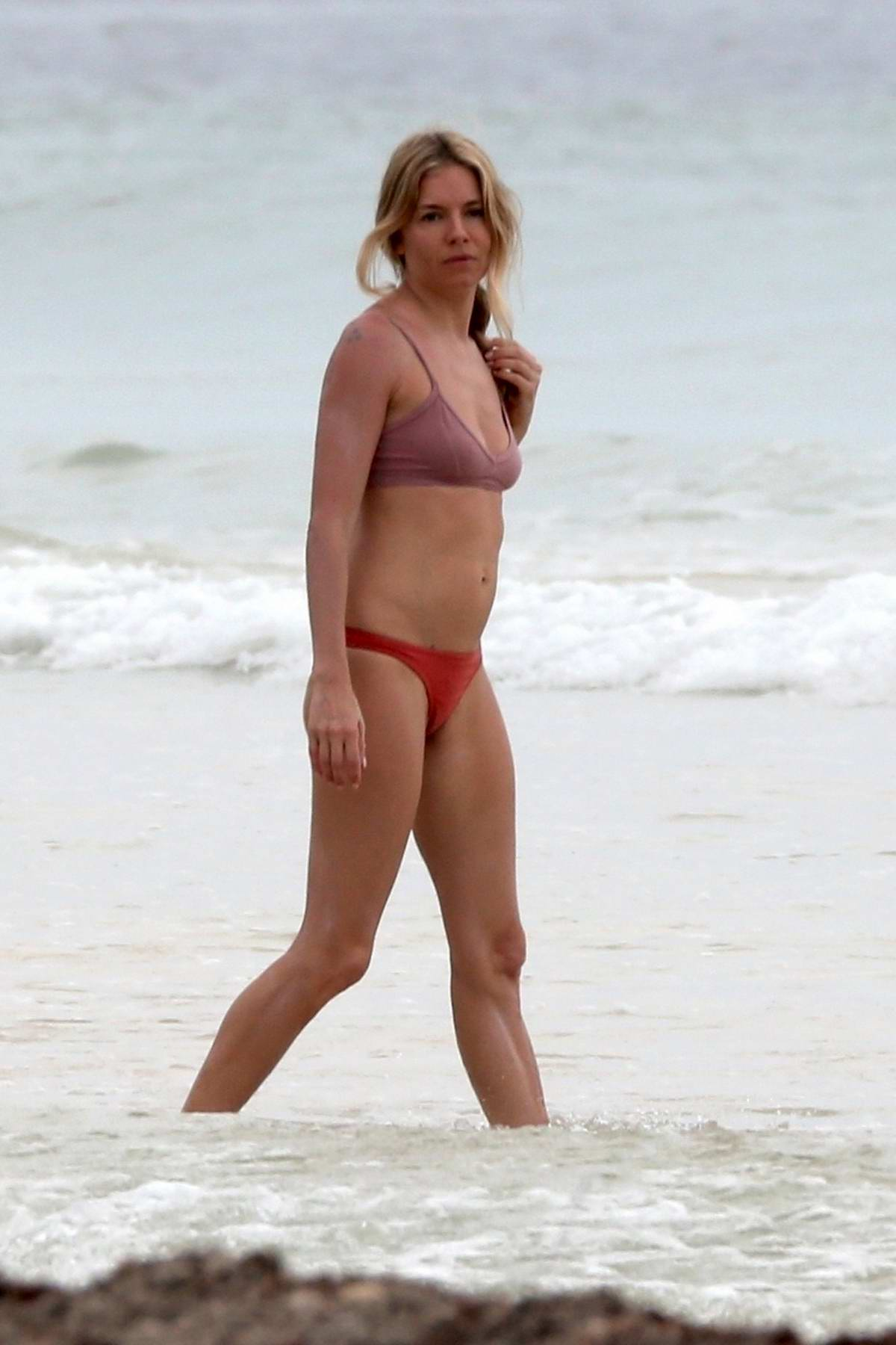 Sienna Miller spotted in a bikini while enjoying the beach with her daughter in Tulum, Mexico
