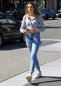 Sistine Stallone looks pretty in a light blue top, blue jeans and white sneakers while out shopping in Beverly Hills, Los Angeles