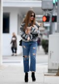 Sofia Vergara carries her pup after lunch at Il Pastaio in Beverly Hills, Los Angeles
