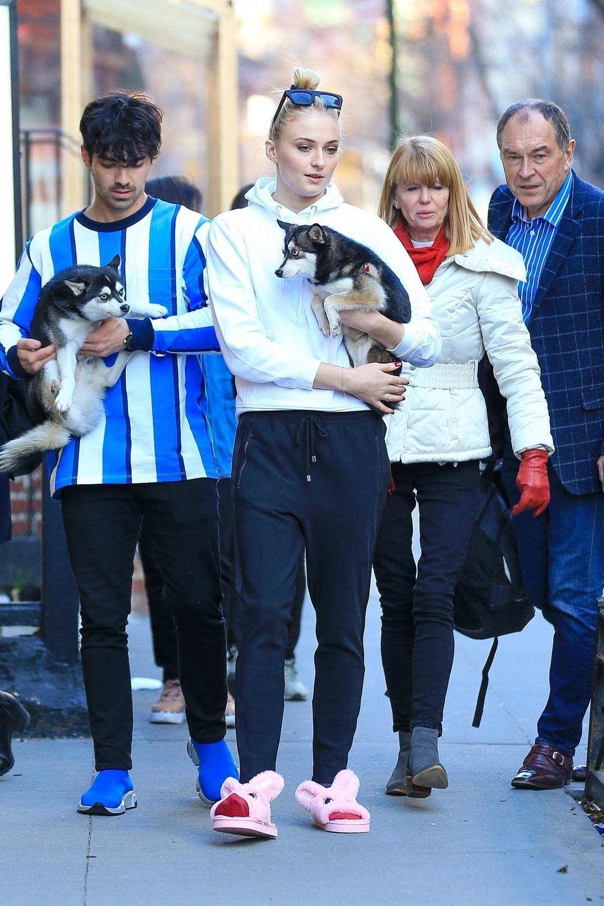 Sophie Turner and Joe Jonas step out with their husky pups as they say goodbye to Sophie's parents in New York City