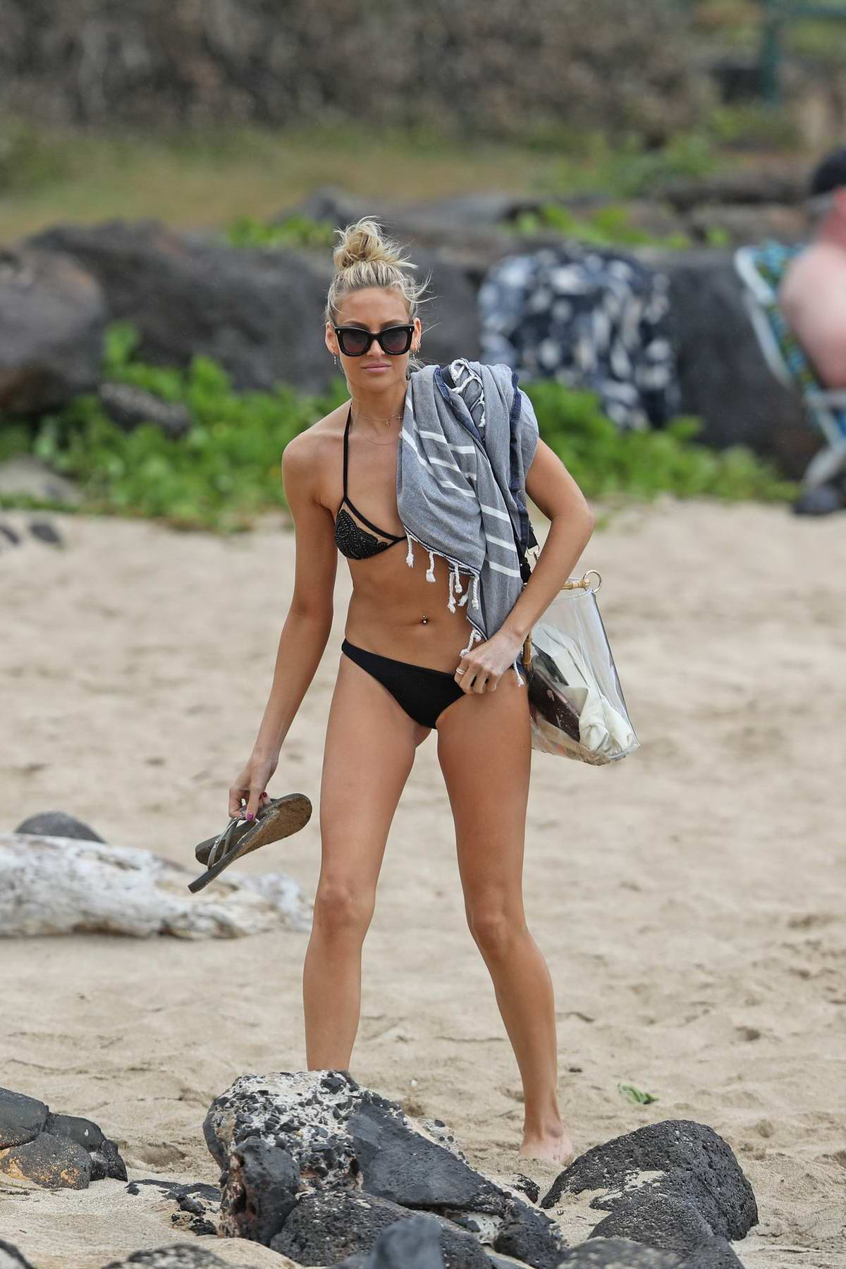 Stephanie Pratt wears a black bikini during a beach day in Hawaii
