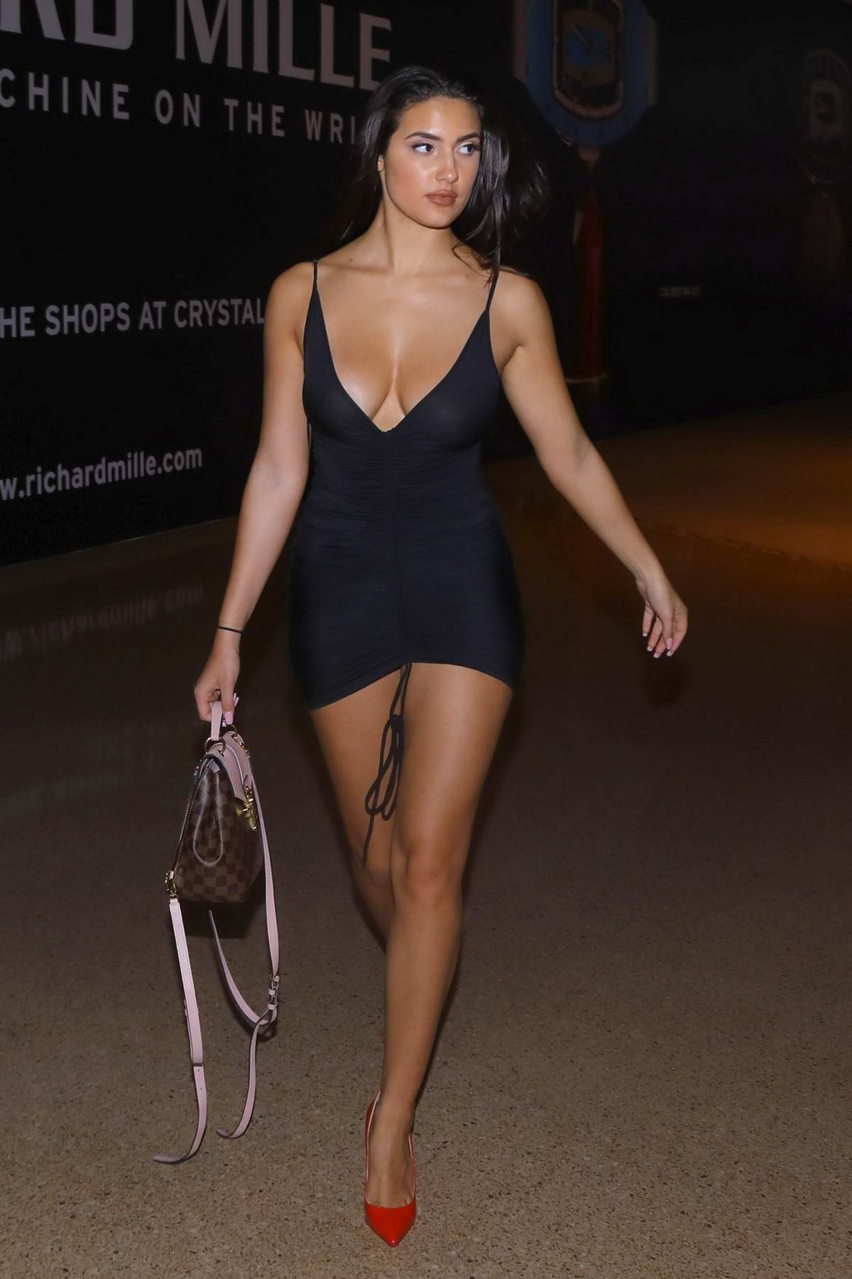 Tao Wickrath sizzles in a plunging black mini dress while out shopping at a luxury mall in Las Vegas
