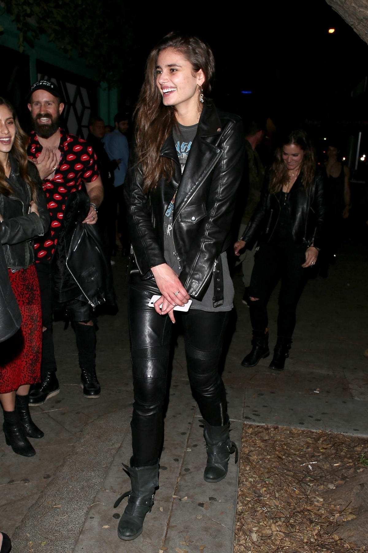 Taylor Hill is all smiles as she leaves the Peppermint nightclub in West Hollywood, Los Angeles