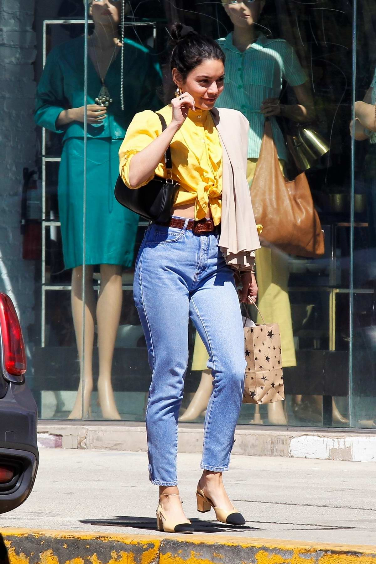 Vanessa Hudgens dons cute yellow blouse and jeans while out in Hollywood, California