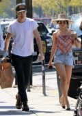 Vanessa Hudgens takes on LA heat donning chic bandana top during lunch outing with boyfriend Austin Butler in Los Angeles