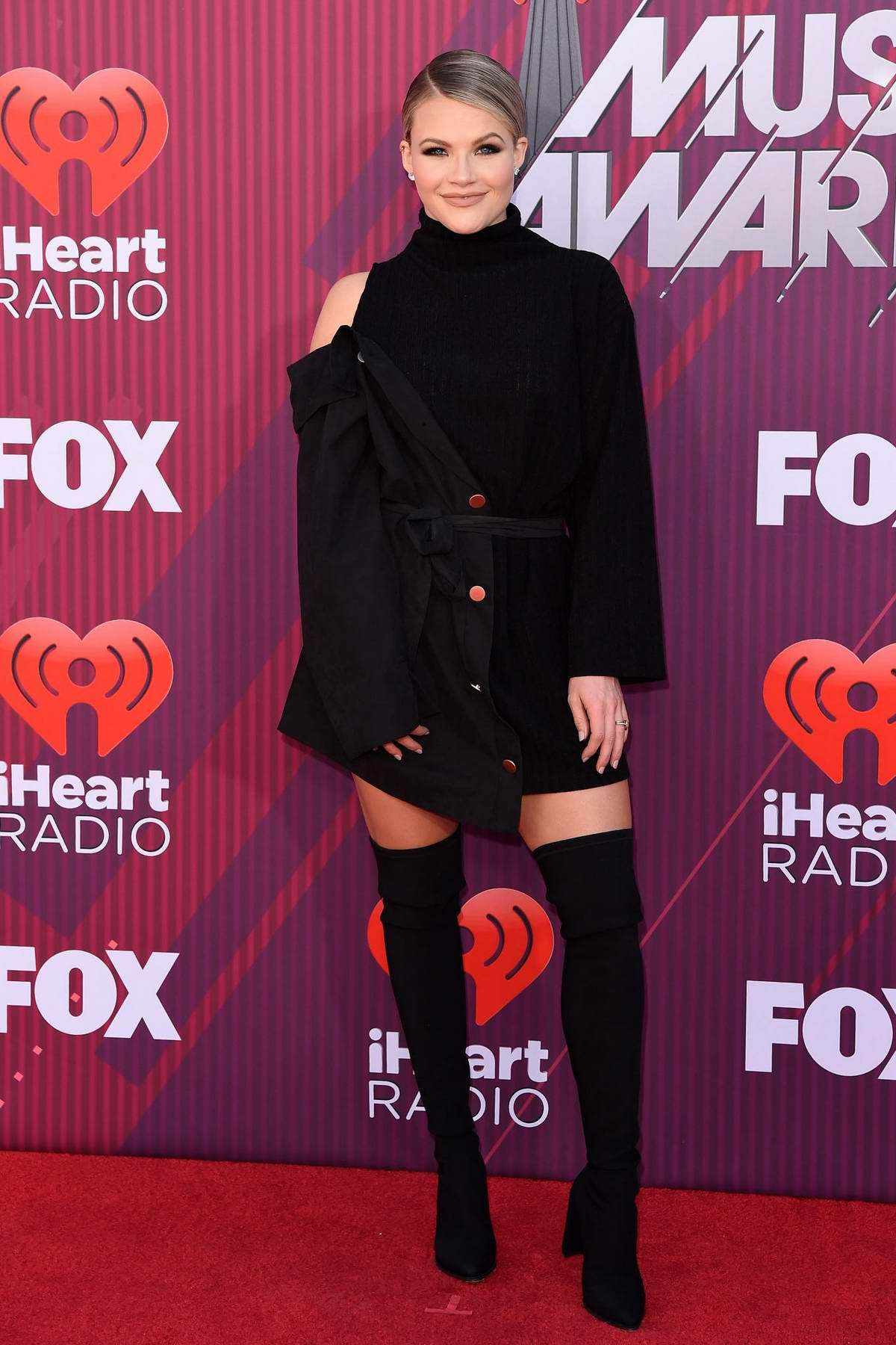 Witney Carson attends the 2019 iHeartRadio Music Awards at Microsoft Theater in Los Angeles