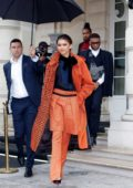 Zendaya steps out in a bright orange during Paris Fashion Week in Paris, France