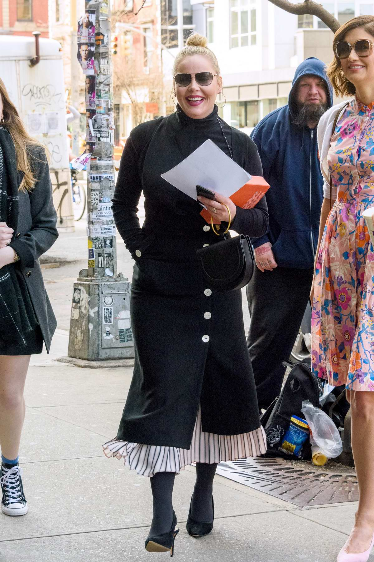 Abbie Cornish dressed in a long black coat over a dress, and black boots while out in New York City