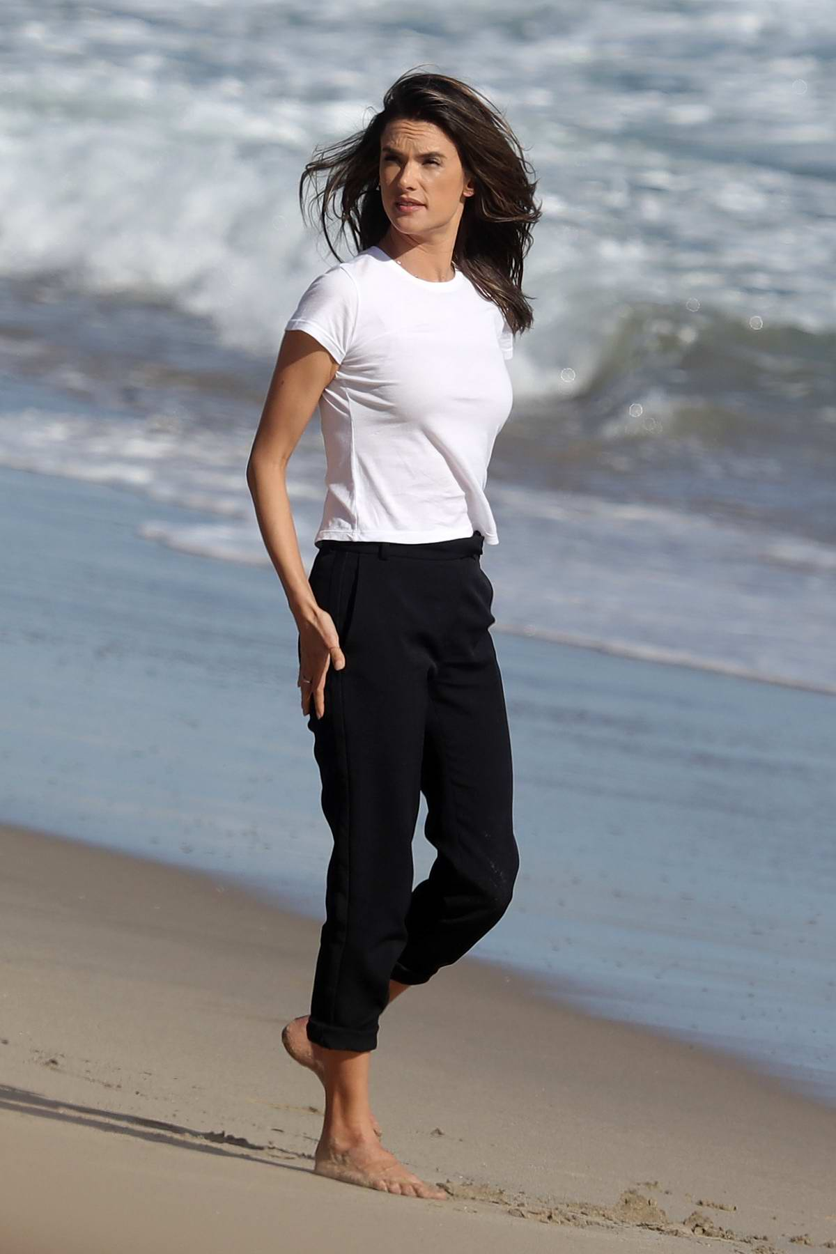 Alessandra Ambrosio enjoys the serenity during a photoshoot at the beach in Malibu, California