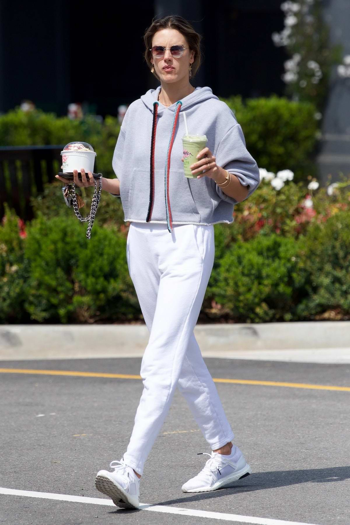 Alessandra Ambrosio grabs a green smoothie and some dessert while out in Los Angeles