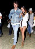 Alessandra Ambrosio holds on tight to Nicolo Oddi while out during Coachella in Indio, California