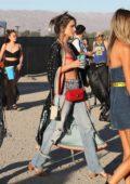 Alessandra Ambrosio spotted holding a drink as she walks into Coachella in Indio, California