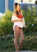 Alessandra Ambrosio stuns in a red bikini during a photoshoot in Santa Monica, California