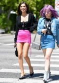Amanda Steele rocks a black top with a pink mini skirt while out with a friend in Los Angeles