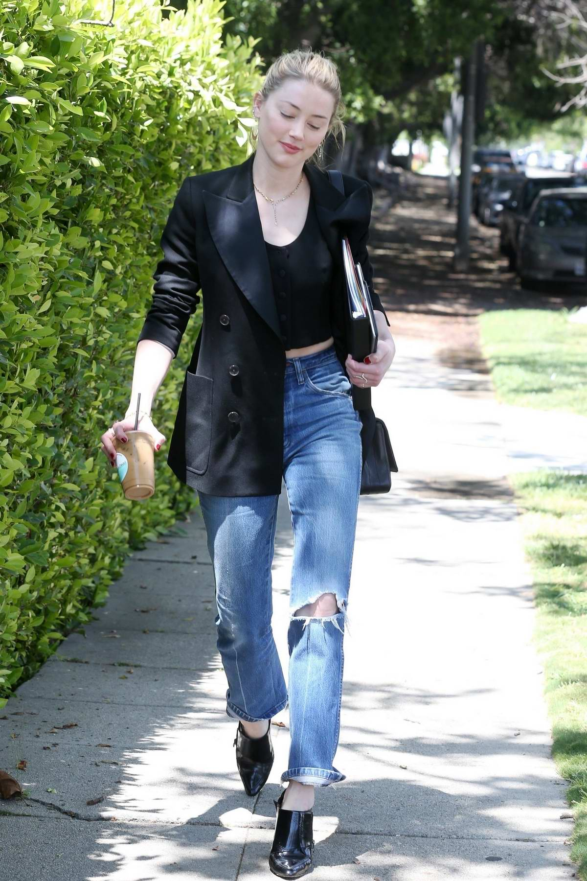 Amber Heard looks chic in a black blazer, black top and ripped jeans as she heads to a meeting in Los Angeles
