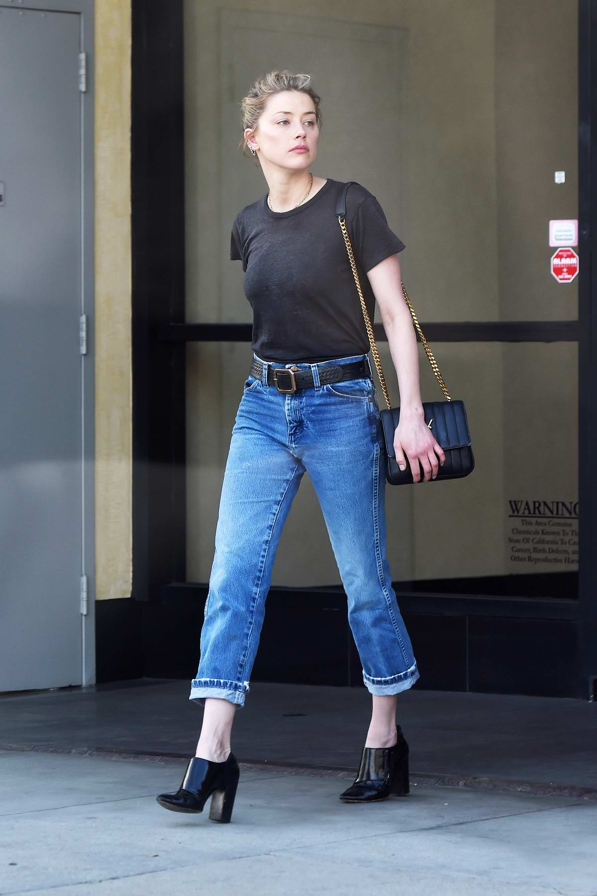 Amber Heard seen hugging a friend before heading out to run errands in Los Angeles