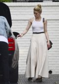Amber Heard tries to hitch a ride on a friend's back as she arrives at the Chateau Marmont Hotel in Los Angeles
