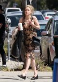Amber Heard wears a floral dress while out shopping with Andy Muschietti at Fred Seagel's before catching a movie in Los Angeles