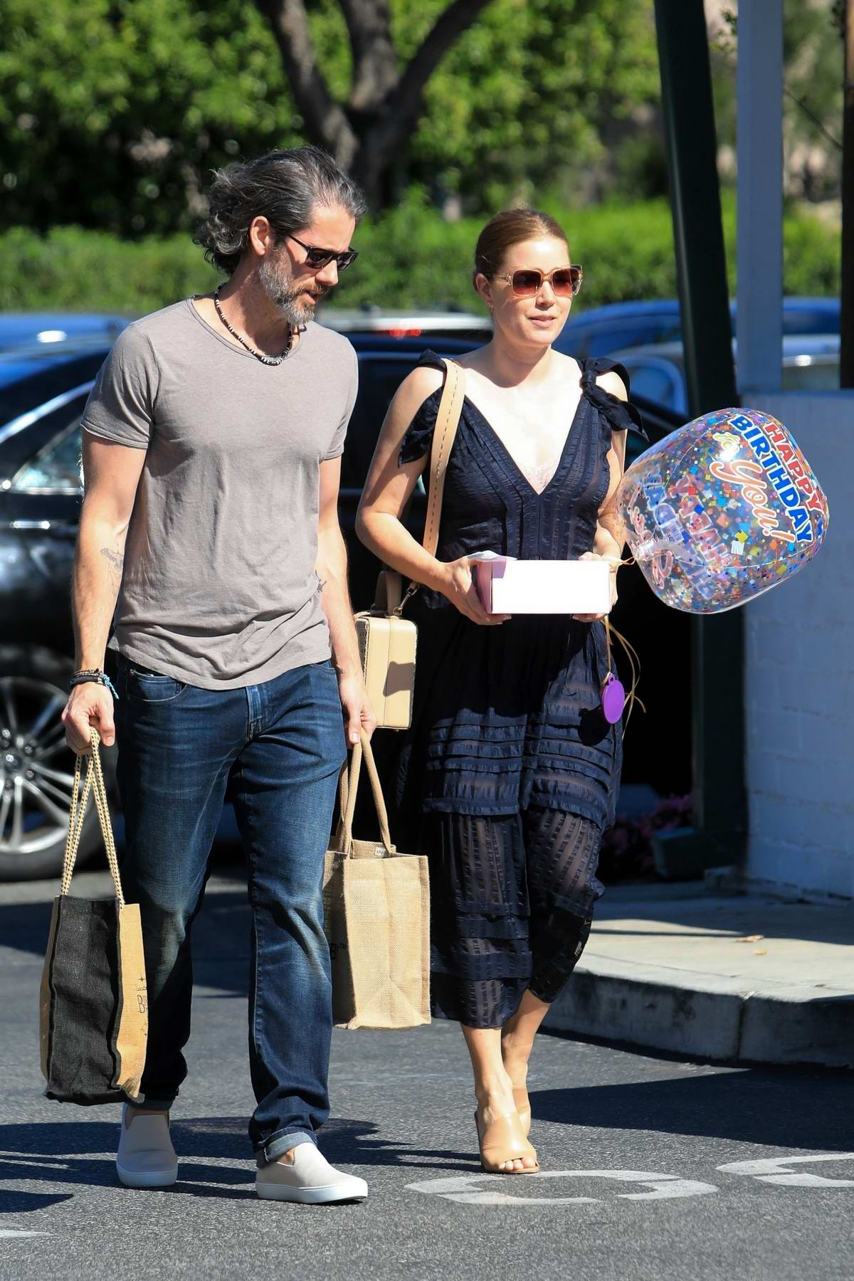 Amy Adams and husband Darren Le Gallo shops for Birthday balloons and cake at Bristol Farms in Beverly Hills, Los Angeles