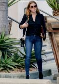 Amy Adams smiles for the camera in her skin tight jeans as she leaves a studio after a business meeting in Los Angeles